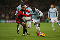 Football - 2017 / 2018 Premier League - AFC Bournemouth vs. West Ham United<br /> <br /> Arthur Masuaku of West Ham United shrugs off the challenge from Bournemouth's Joshua King at Dean Court (Vitality Stadium) Bournemouth <br /> <br /> COLORSPORT/SHAUN BOGGUST
