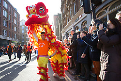 © licensed to London News Pictures. London, UK 02/02/2014. Chinese New Year Parade goes through streets of London to celebrate Chinese New Year, The Year of the Horse with Londoners on Sunday, 02 February 2014. Photo credit: Tolga Akmen/LNP
