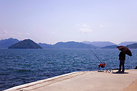 """Fishing at Ujina Port Hiroshima -  The Inland Sea, or """"Seto Naikai"""" as it is known in Japanese is the body of water separating Honshu, Shikoku  and Kyushu - Japan's main islands.  The Inland Sea, because of its calm waters and strategic location among the main islands, has always been an important transportation link for Japan."""