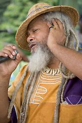 Reggae singer performing at music festival at Nottingham Arboretum; 2005