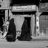 Egypt. Cairo : Al Mu'izz LI  DIN Allah street street life in front of SULTAN AL Muyyad - Mu'ayyad - mosque in Bab Zuwayla area. old islamic cairo