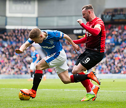 Rangers' Greg Docherty (left) is tripped by Kilmarnock's Kris Boyd battle for the ball during the Ladbrokes Scottish Premiership match at Ibrox Stadium, Glasgow.