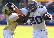 Tulsa tight end Garrett Mills, right, stiff-arms UCF defensive back Joe Burnett during the first half of the C-USA Championship Game in Orlando, Florida.