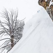 Andrew Whiteford grabs some air in blower powder winter storm in-bounds at Jackson Hole Mountain Resort.