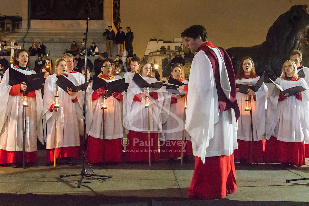 Trafalgar Square, London, December 6th 2015. The Christmas spirit ramps up in Trafalgar Square with the blessing of the crib led by the Rev Dr Sam Wells and  featuring the Chalk Farm Salvation Army Band and the Choir from St Martin-in-the-Field church in Trafalgar Square. The crib is designed by Tomoaki Suzuki, with figures inspired by London's diverse population and will be on display in the square throughout December. ///FOR LICENCING CONTACT: paul@pauldaveycreative.co.uk TEL:+44 (0) 7966 016 296 or +44 (0) 20 8969 6875. ©2015 Paul R Davey. All rights reserved.