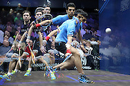 a multiple exposure image as Omar Mosaad of Egypt (wearing light Blue shirt) hits a shot against Mathieu Castagnet of France (wearing Black shirt)the Final, Omar Mosaad of Egypt v Mathieu Castagnet of France , Canary Wharf Squash Classic 2016 , at the East Wintergarden in Canary Wharf , London on Friday 11th March 2016.<br /> pic by John Patrick Fletcher, Andrew Orchard sports photography.