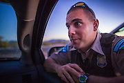 "03 MAY 2012 - VEKOL VALLEY, RURAL PINAL COUNTY, AZ:   BLM Ranger Jason Marsoobian (CQ) talks to his shift supervisor Jon Young (CQ Jon - not in photo) during their shift on Bureau of Land Management land south of Interstate 8 and west of Casa Grande in rural Pinal County. The area has been a hotbed of illegal immigrant and drug smuggling for years. The BLM has undertaken a series of ""surges"" in the area, increasing their law enforcement patrols and partnering with Border Patrol and Pinal County Sheriff's Department officers to reduce criminal activity in the area.        PHOTO BY JACK KURTZ"