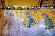 Byzantine Deësis ( Entreaty) mosaic , 1261, in which the Virgin Mary & John The Baptist,  both shown in three-quarters profile, are imploring the intercession of Christ Pantocrator for humanity on Judgment Day.   Hagia Sophia, Istanbul, Turkey .<br /> <br /> If you prefer to buy from our ALAMY PHOTO LIBRARY  Collection visit : https://www.alamy.com/portfolio/paul-williams-funkystock/istanbul.html<br /> <br /> Visit our TURKEY PHOTO COLLECTIONS for more photos to download or buy as wall art prints https://funkystock.photoshelter.com/gallery-collection/3f-Pictures-of-Turkey-Turkey-Photos-Images-Fotos/C0000U.hJWkZxAbg