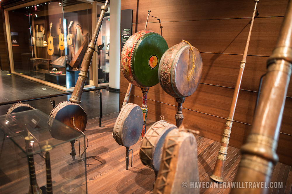Asian drums and horns on display at the Musical Instrument Museum in Brussels. The Musee des Instruments de Musique (Musical Instrument Museum) in Brussels contains exhibits containing more than 2000 musical instruments. Displays include historical, exotic, and traditional cultural instruments from around the world. Visitors to the museum are given handheld audio guides that play musical demonstrations of many of the instruments. The museum is housed in the distinctive Old England Building.
