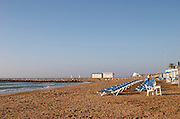 The beach. Rows of empty deck chairs. Sitges, Catalonia, Spain