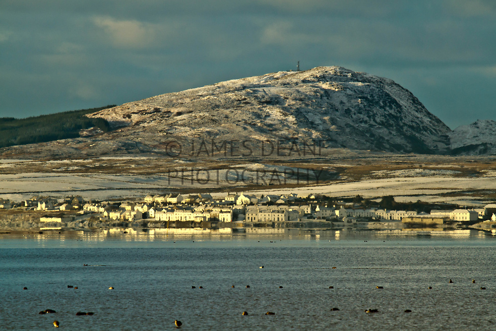 A telephoto shot across Loch Indaal of Port Charlotte in Winter