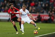 Stephen Kingsley of Swansea city holds off Juan Mata of Manchester Utd. Premier league match, Swansea city v Manchester Utd at the Liberty Stadium in Swansea, South Wales on Sunday 6th November 2016.<br /> pic by  Andrew Orchard, Andrew Orchard sports photography.