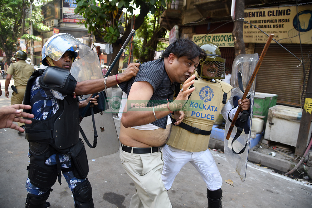 May 25, 2017 - Kolkata, India - Several Bharatiya Janta Party (BJP) workers clashed with police during their march to the police headquarters in Kolkata on May 25, 2017 demanding the arrest of ''corrupt'' Trinamool Congress leaders, prompting the force to use teargas shells, water canons and batons to disperse them. Top leaders of BJP were arrested by the cops. Protesters throw bombs on police. (Credit Image: © Tanmoy Bhaduri/Pacific Press via ZUMA Wire)