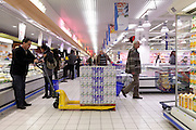 restocking of shelf at a supermarket France Europe