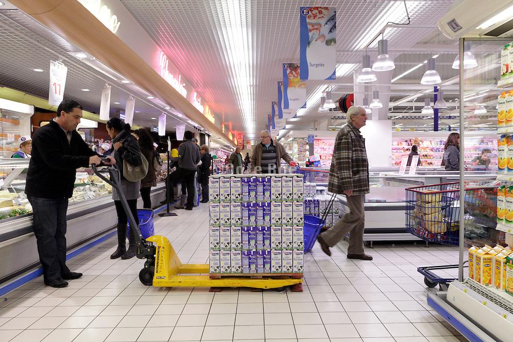 restocking of shelf at a supermarket France Europe