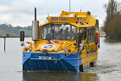 """© Licensed to London News Pictures. 10/02/2014. Old Windsor, UK. A """"duck tour"""" vehicle used on the Thames was  was hired to facilitate the rescue of members of the village.   Flooding in OLD WINDSOR in Berkshire today 10th February 2014 after the River Thames burst its banks. The Environment Agency has issued 14 Severe Flood Warnings alone the Thames. Photo credit : Stephen Simpson/LNP"""