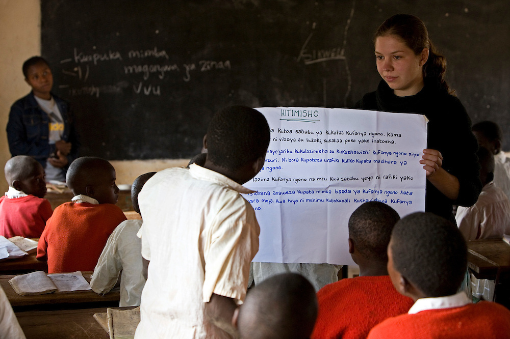 Val Indaouse, an international Student Partnerships Worldwide (SPW) volunteer from Cornwall, teaches sex education to school children at Ikuna village primary school in Tanzania.