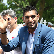 CANASTOTA, NY - JUNE 14: Boxer Amir Khan poses while riding in a car during the parade at the International Boxing Hall of Fame induction Weekend of Champions events on June 14, 2015 in Canastota, New York. (Photo by Alex Menendez/Getty Images) *** Local Caption *** Amir Khan