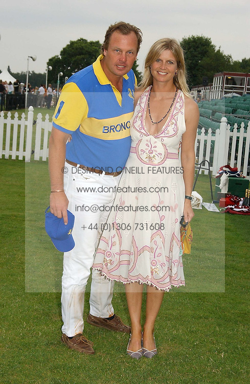 The MARQUESS & MARCHIONESS OF MILFORD HAVEN at the Queen's Cup polo final sponsored by Cartier at Guards Polo Club, Smith's Lawn, Windsor Great Park on 18th June 2006.  The Final was between Dubai and the Broncos polo teams with Dubai winning.<br /><br />NON EXCLUSIVE - WORLD RIGHTS