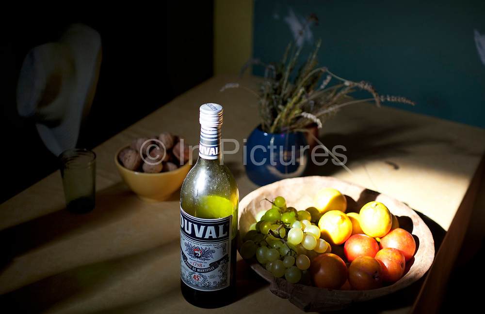 Scene inside a French country village house. This classical place with it's objects looks like a still life of French living. Fruit, nuts, lavendar and Duval.
