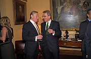 John Smith and Urik Jaroz. Reception to support the Hyde Park Appeal for Liberty Drives ( a charity which enables people to travel around Hyde Park in electric buggies) in the presence of Prince Michael of Kent. Officers Mess. Household Cavalry Mounted Regiment. Hyde Park Barracks. 30 November 2004. ONE TIME USE ONLY - DO NOT ARCHIVE  © Copyright Photograph by Dafydd Jones 66 Stockwell Park Rd. London SW9 0DA Tel 020 7733 0108 www.dafjones.com