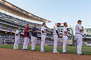 Jamey Carroll #8, Kyle Gibson #44, Caleb Thielbar #56, Justin Morneau #33, Pedro Florimon #25, and Josh Willingham #16 stand during the national anthem before a game against the Kansas City Royals on June 27, 2013 at Target Field in Minneapolis, Minnesota.  The Twins defeated the Royals 3 to 1.  Photo by Ben Krause