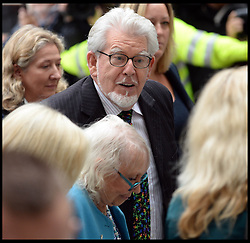 """Artist and television personality Rolf Harris arrives with his wife Alwen Hughes and their daughter with their daughter Bindi at The City of Westminster Magistrates Court, London, England. Mr Harris, who was arrested in March by police officers working for Operation Yewtree, has been charged with nine counts of indecent assault on teenage girls and four counts of making indecent images of children, United Kingdom. Monday, 23rd September 2013. Picture by Andrew Parsons / i-Images<br /> File photo - Rolf Harris is facing three further prosecutions for sexual assault including one against girl """"aged seven or eight"""", prosecutors have said.<br /> Photo filed Monday 23rd December 2013"""