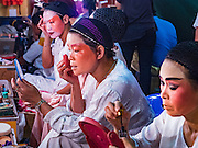 15 OCTOBER 2015 - BANGKOK, THAILAND:  Chinese opera performers puts on their make up before performing at the Vegetarian Festival at the Joe Sue Kung Shrine in the Talat Noi neighborhood of Bangkok. The Vegetarian Festival is celebrated throughout Thailand. It is the Thai version of the The Nine Emperor Gods Festival, a nine-day Taoist celebration beginning on the eve of 9th lunar month of the Chinese calendar. During a period of nine days, those who are participating in the festival dress all in white and abstain from eating meat, poultry, seafood, and dairy products. Vendors and proprietors of restaurants indicate that vegetarian food is for sale by putting a yellow flag out with Thai characters for meatless written on it in red. The shrine is famous for the Chinese opera it hosts during the Vegetarian Festival. The operas are free.   PHOTO BY JACK KURTZ