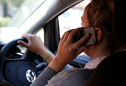 Embargoed to 0001 Monday June 26 NOTE POSED BY MODEL File photo dated 13/08/14 of a woman using a mobile phone while driving. A road safety campaign aimed at stopping people using their phone while driving has been launched in Scotland.