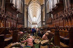 © licensed to London News Pictures. Salisbury Cathedral, Wiltshire UK  13/06/11. ..Over 500 volunteer flower arrangers meet at Salisbury Cathedral in Wiltshire to help create the spectacular flower festival at Salisbury Cathedral...Please see special instructions for usage rates. Photo credit should read Ian Forsyth/LNP