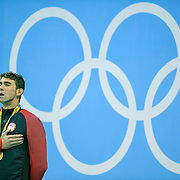 United States swimmer Michael Phelps took a deep breath while listening to the National Anthem after winning the gold medal in the men's 200m individual medley on Thursday at the Olympic Aquatics Stadium during the 2016 Summer Olympics Games in Rio de Janeiro, Brazil.