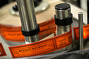 Labels wait to be applied to bottles of Bulleit bourbon at Stitzel Weller home of Bulleit bourbon in Louisville, Ky. on Monday March 16, 2015.<br /> <br /> Photos by William DeShazer