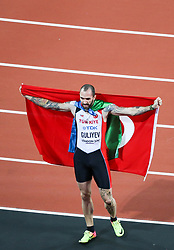 London, August 10 2017 . Ramil Guliyev, Turkey, is draped in the flag of azerbaijan, his country of birth and the Turkish flag of his adopted homeland after winning the men's 200m final on day seven of the IAAF London 2017 world Championships at the London Stadium. © Paul Davey.