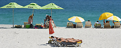 Cape Town-181007- The rise in temperatures in the Mother City caused people to cool-off at the beach,Camps Bay is one of them.It is 32 degrees in Cape Town and as early as 8am,you could feel the heat.Some parents took their kids on this last day of spring school holidays to have fun on the beach  .Photographer:Phando Jikelo/African News Agency(ANA)