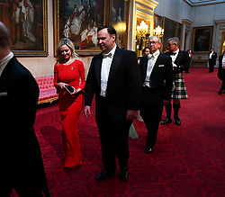 Kathryn Parsons and Daniel Scavino arrive through the East Gallery during the State Banquet at Buckingham Palace, London, on day one of the US President's three day state visit to the UK.