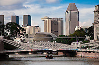 Looking down the Singapore River past the Cavanagh Street Bridge to the futuristic Esplanade Theatre.