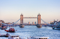 tower bridge viewed from london bridge in january 2010 and evening falls and the light turn on
