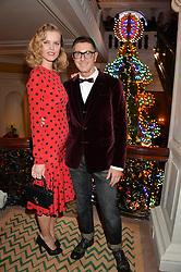 STEFANO GABBANA and EVA HERZIGOVA at the Claridge's Christmas Tree By Dolce & Gabbana Launch Party held at Claridge's, Brook Street, London on 26th November 2013.
