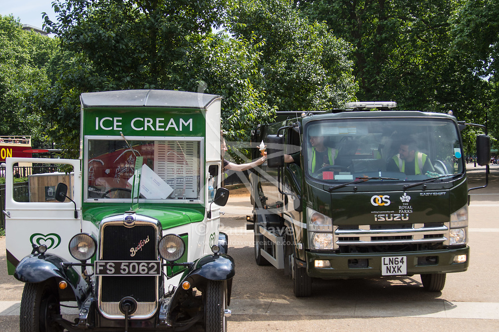 London, June 2nd 2017.  Workers in a van buy ice creams in a humid Hyde Park as clouds build up ahead of forecast thunderstorms.
