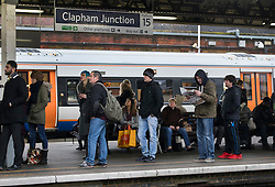 CAPTION CORRECTION © Licensed to London News Pictures. 19/12/2016. London, UK. Passengers wait for trains at Clapham Junction. Some Southern Rail services are running today as ASLEF union drivers started a two day strike in a dispute over driver-only operated trains. Photo credit: Peter Macdiarmid/LNP