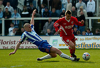 Photo: Jed Wee.<br />Hartlepool United v Bristol City. Coca Cola League 1. 15/04/2006.<br /><br />Bristol City's Scott Brown (R) is tackled by Hartlepool's Michael Nelson.