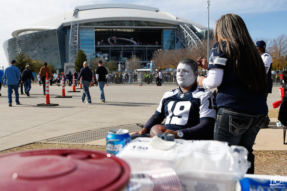 Juan Rodriguez from Edinburg gets his face painted by Melinda Balderas before the Cowboys game against the Pittsburgh Steelers at Cowboys Stadium in Arlington, Texas, on December 16, 2012.  (Stan Olszewski/The Dallas Morning News)