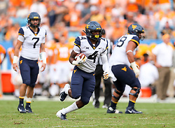 Sep 1, 2018; Charlotte, NC, USA; West Virginia Mountaineers running back Leddie Brown (4) runs the ball during the second quarter against the Tennessee Volunteers at Bank of America Stadium. Mandatory Credit: Ben Queen-USA TODAY Sports
