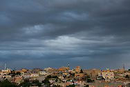 Skyline of Midyat, Turkey, including a minaret (left) and the bell towers of two Syriac churches (center and right).
