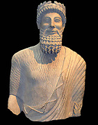 Colossal limestone statue of a bearded man
