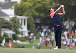 April 7, 2018 - Augusta, GA, USA - Justin Rose hits from the 1st fairway during the third round of the Masters Tournament on Saturday, April 7, 2018, at Augusta National Golf Club in Augusta, Ga. (Credit Image: © Jason Getz/TNS via ZUMA Wire)
