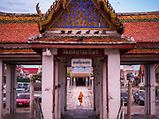 28 SEPTEMBER 2015 - BANGKOK, THAILAND: A monk walks to the Wat Kalayanamit pier to catch a ferry to go to the Bangkok side of the Chao Phraya River.     PHOTO BY JACK KURTZ