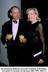 MR RANDALL BROOKS and MRS CHARLES ST.GEORGE, at a party in London on January 30th 1997.LWD 14