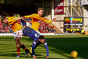 Jake Mulraney of Hearts fouled by Allan Campbell of Motherwell during the Ladbrokes Scottish Premiership match between Motherwell and Heart of Midlothian at Fir Park, Motherwell, Scotland on 17 February 2019.