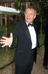 LORD ARCHER at a fund raising event for The Galapagos Conservation Trust entitled 'Some Enchanted Evening' at the Chelsea Physic Garden Chelsea, London on 17th June 2004.